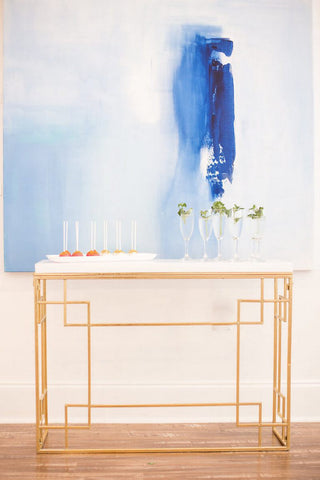 In too deep painting by Chris Brandell in a room with decorated table