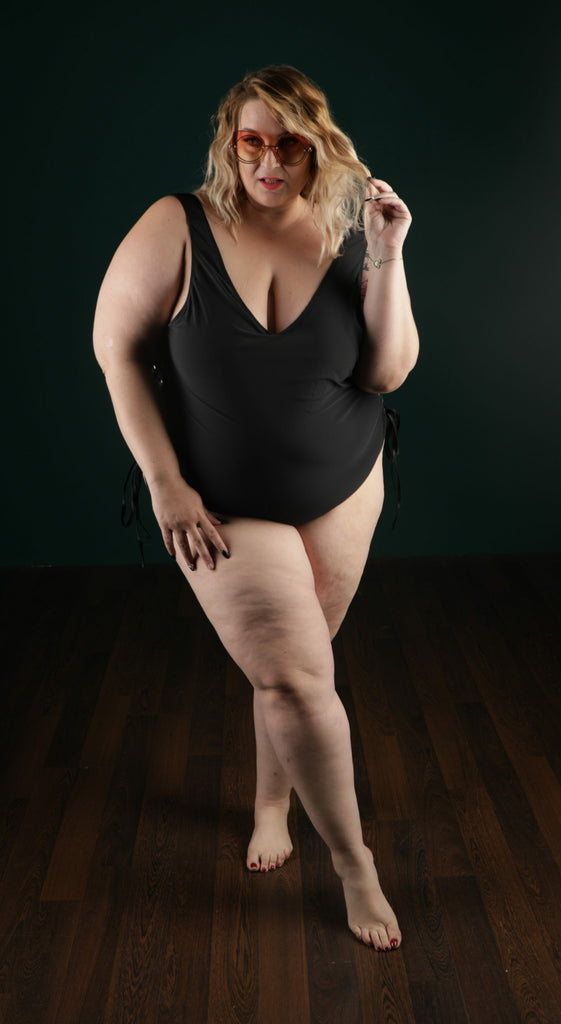 """All Tied Down"" black swimsuit with side grommets"