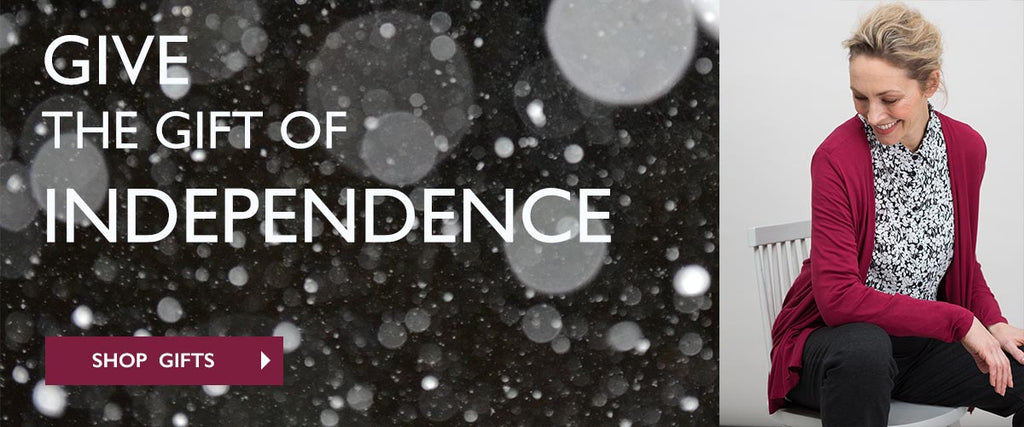 Give the gift of independence banner with lady wearing monochrome print shirt and red cardi