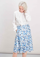 Plain Ivory Blouse with petal print skirt in blue hues
