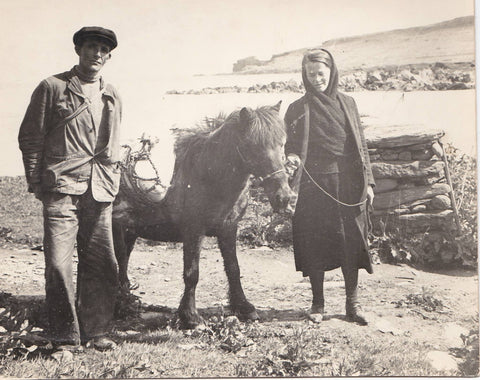 My Great Aunty Betty wearing a hap with Norwick beach in the background