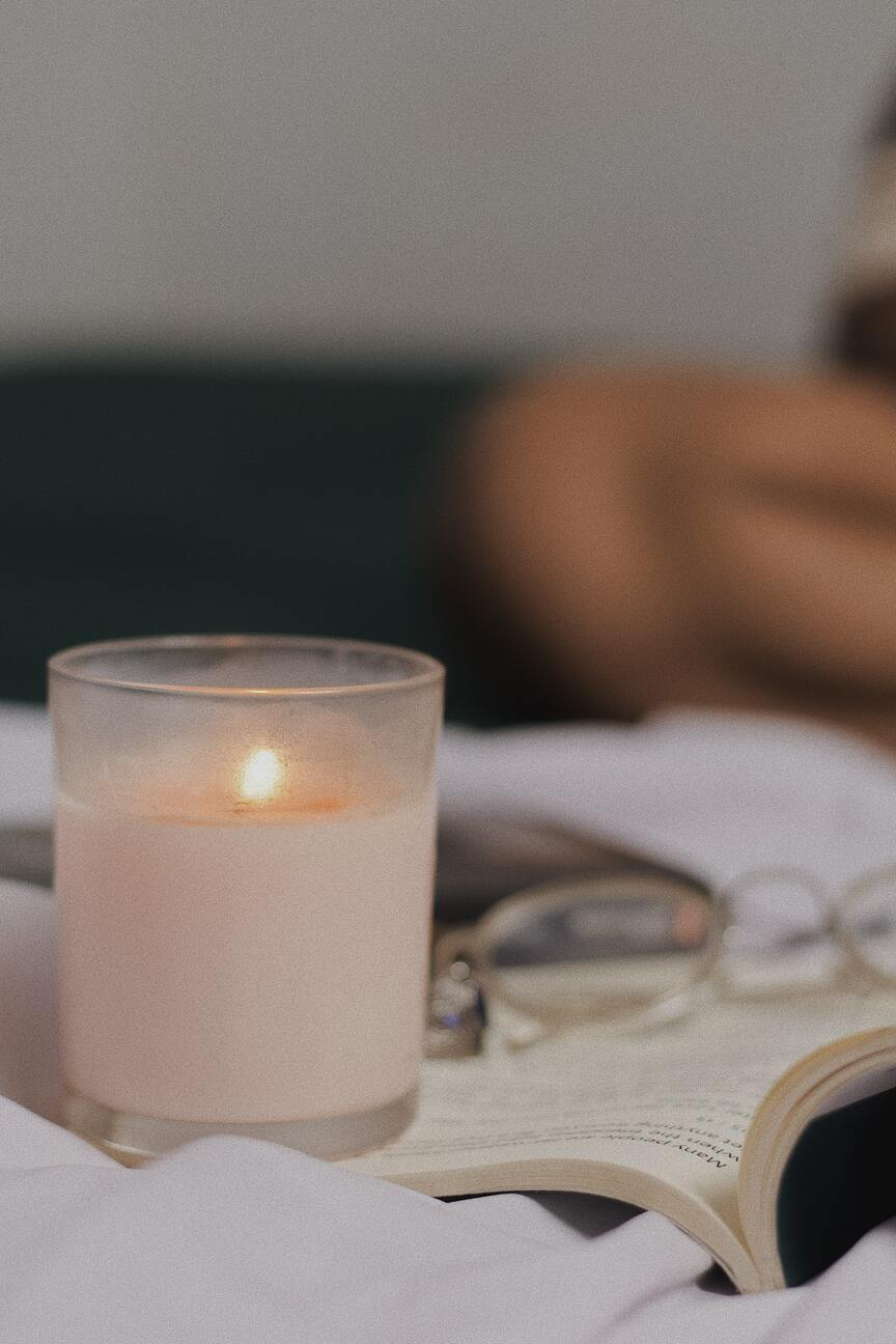 a scented candle while reading