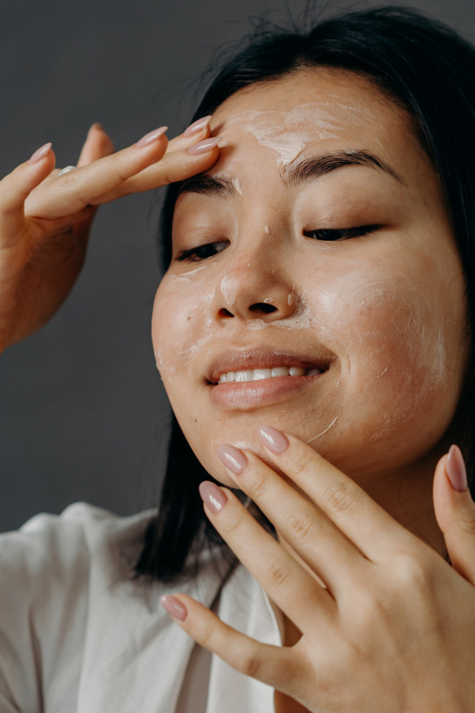 The Ultimate Guide to Exfoliating: what is it and what are the benefits?Girl in White Long Sleeve Shirt