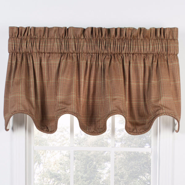 Rust Morrison Lined Scalloped Valance hanging on a curtain rod