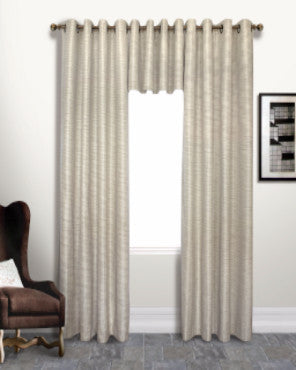 Beige Brighton Lined Grommet Top Panel and Valance hanging on a decorative rod