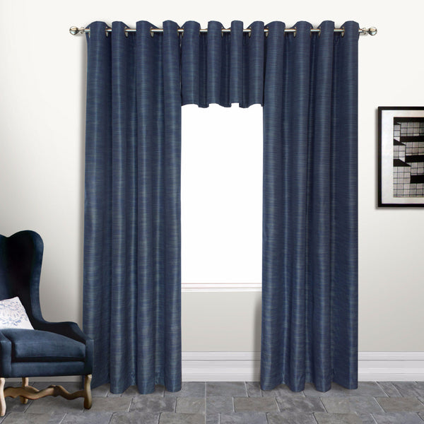 Navy Brighton Lined Grommet Top Panel and Valance hanging on a decorative rod