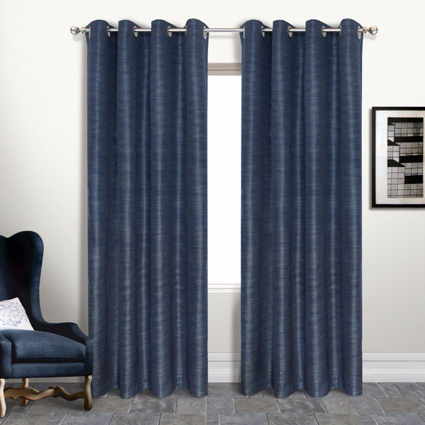 Navy Brighton Lined Grommet Top Panel hanging on a decorative rod