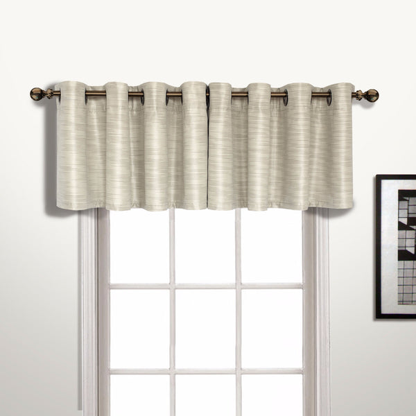 Beige Brighton Lined Grommet Top Valance hanging on a decorative rod