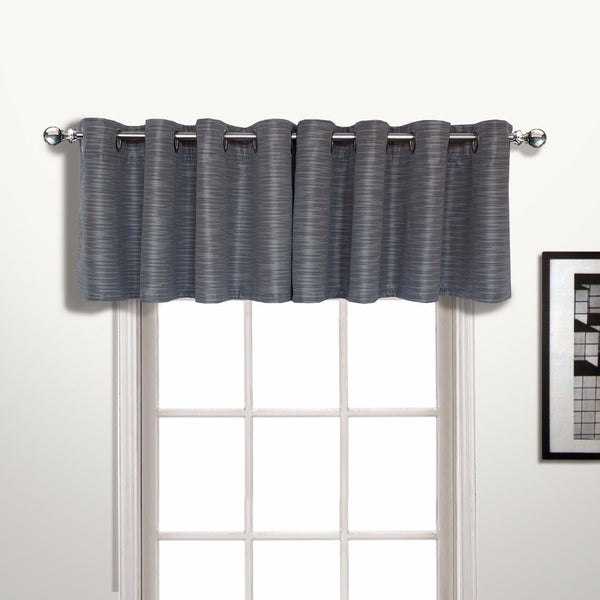 Platinum Brighton Lined Grommet Top Valance hanging on a decorative rod