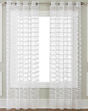 White Amelia Macrame Lace Grommet Top Panel hanging on a decorative curtain rod