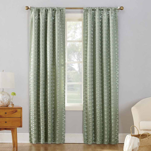 Cucumber Sun Zero Atticus Jacquard Lined Rod Pocket Panels hanging on a decorative rod