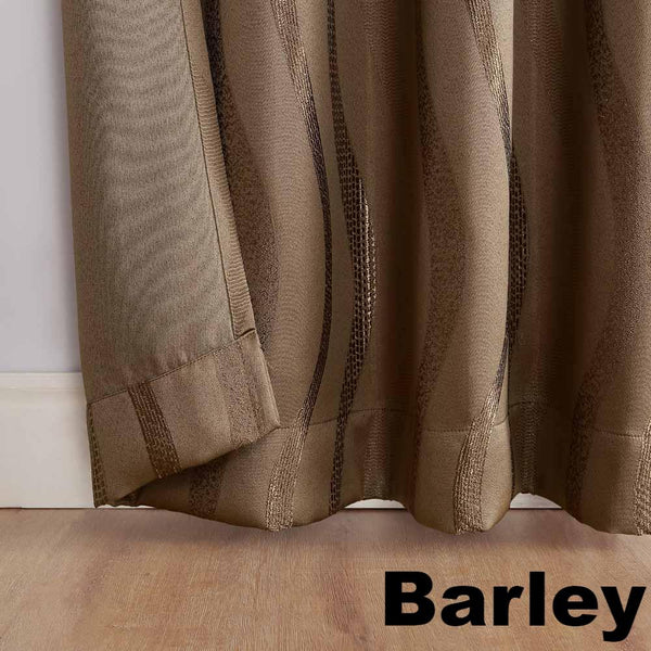 Closeup of barley Sun Zero Ava Room Darkening Grommet Top Panel hem