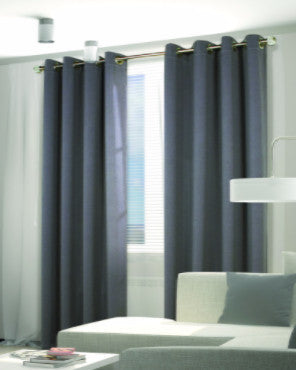 Alloy Grey Belize Woven Blackout Grommet Top Panels hanging on a decorative curtain rod