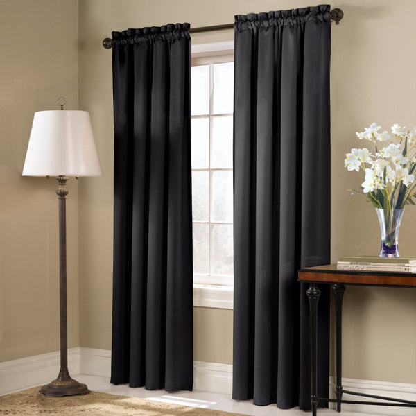 Black Blackstone Blackout Panels and Valance hanging on a decorative rod