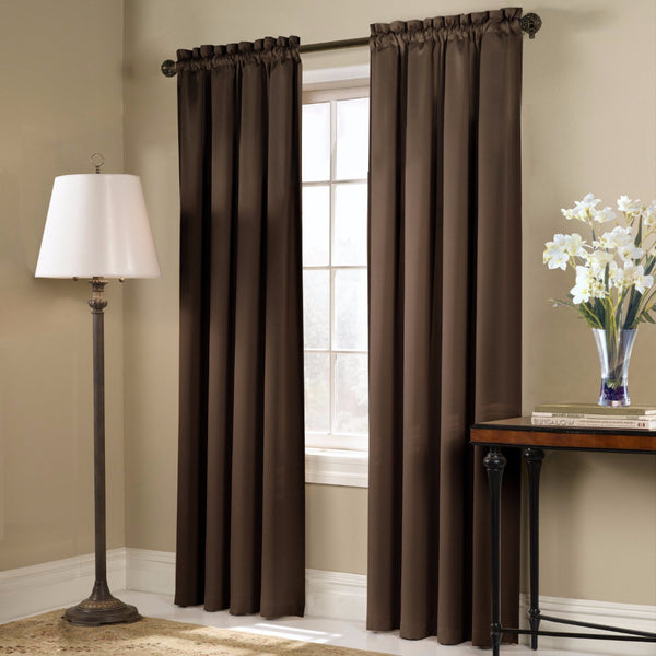 Chocolate Blackstone Blackout Panels and Valance hanging on a decorative rod