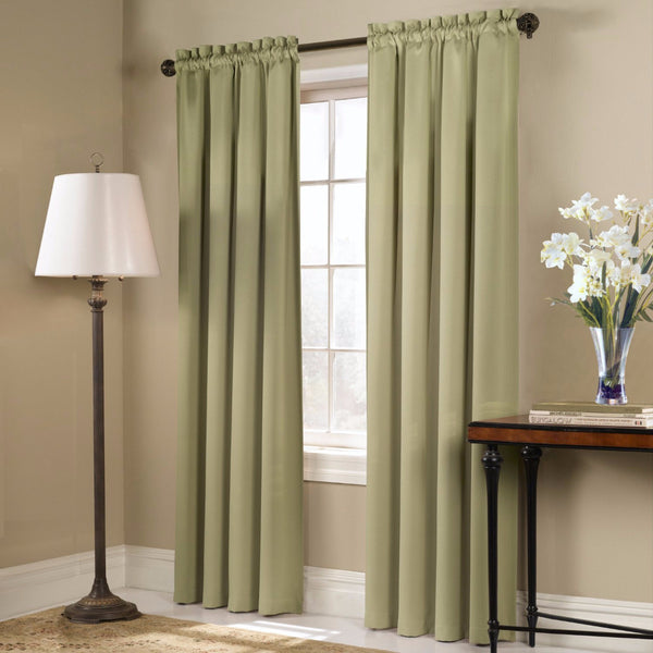 Sage Blackstone Blackout Panels and Valance hanging on a decorative rod