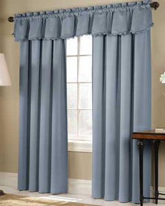 Blue Blackstone Blackout Panels and Valance hanging on a decorative rod
