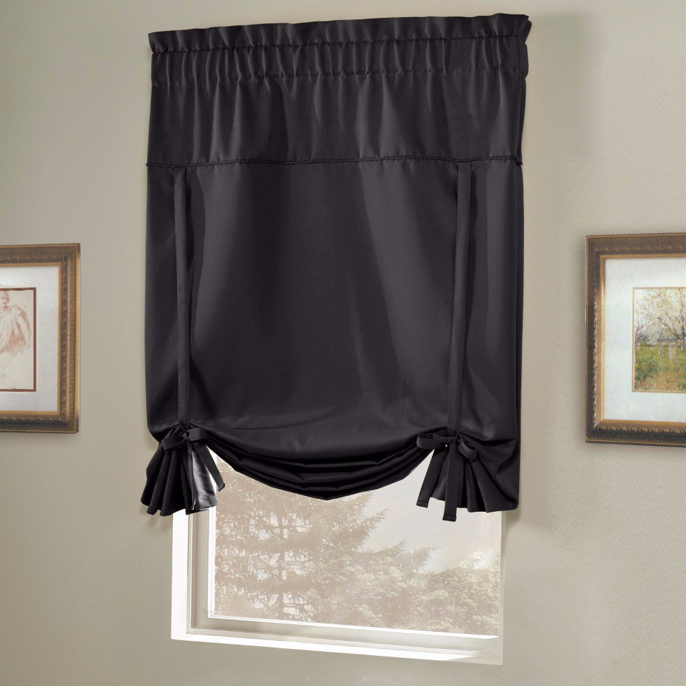 Black Blackstone Tie-up Shade hanging on a curtain rod