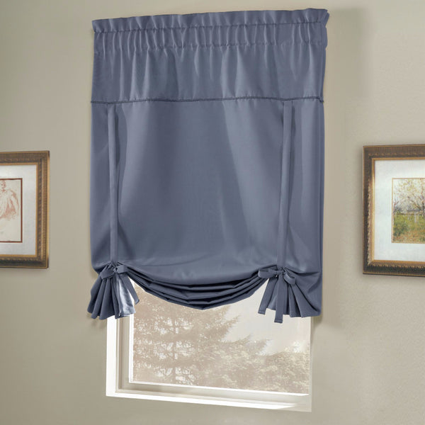 Blue Blackstone Tie-up Shade hanging on a curtain rod