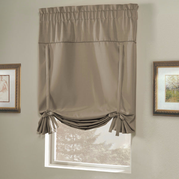 Taupe Blackstone Tie-up Shade hanging on a curtain rod