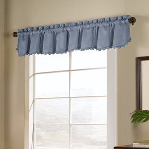 Blue Blackstone Valance hanging on a decorative rod