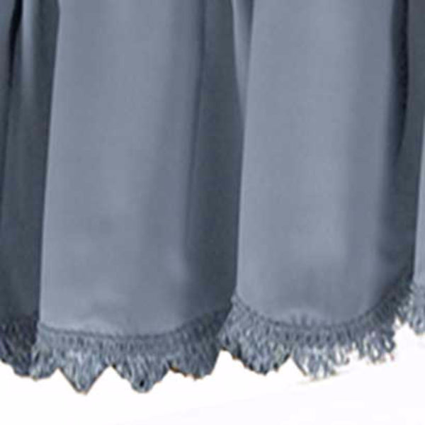 Closeup up of Blue Blackstone valance fabric and fringe