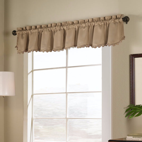 Gold Blackstone Valance hanging on a decorative rod