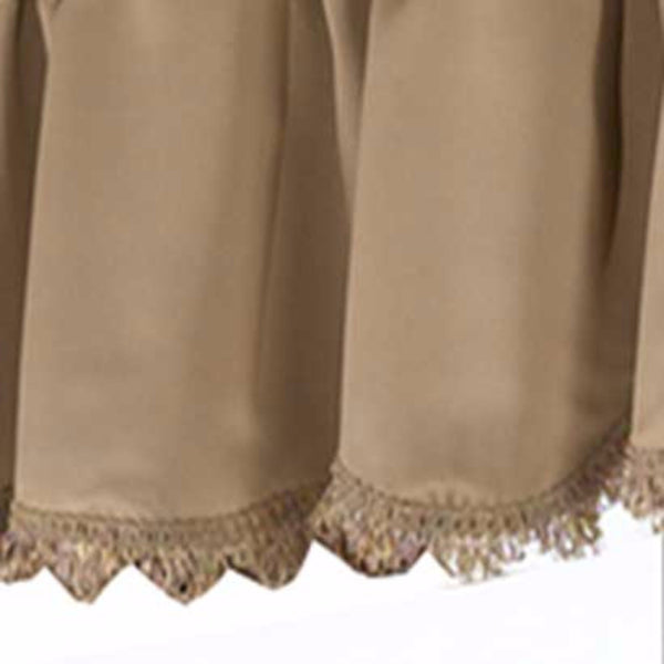 Closeup up of Gold Blackstone valance fabric and fringe