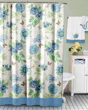 Blue Floral Garden Fabric Shower Curtain by Lenox hanging on a bathroom curtain rod