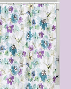 Multi Bouquet Fabric Shower Curtain hanging on a bathroom shower rod