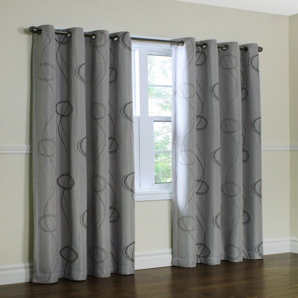 Grey Brooke Printed Grommet Top Panels hanging on a decorative curtain rod