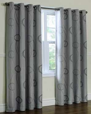 Brooke Printed Grommet Top Panels hanging on a decorative curtain rod
