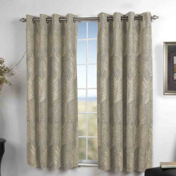 Natural Brookfield Lined Blackout Grommet Top Panel hanging on a decorative curtain rod