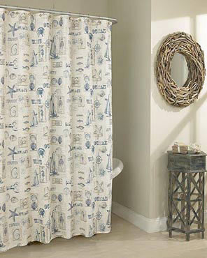 Blue By The Sea Fabric Shower Curtain hanging on a bathroom curtain rod