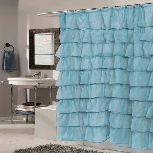 Spa Carmen Ruffled Fabric Shower Curtain hanging on a shower curtain rod