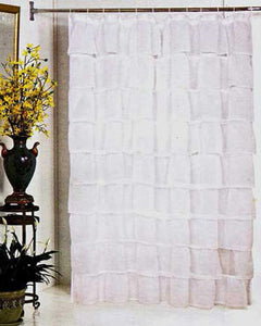 White Carmen Ruffled Fabric Shower Curtain hanging on a shower curtain rod
