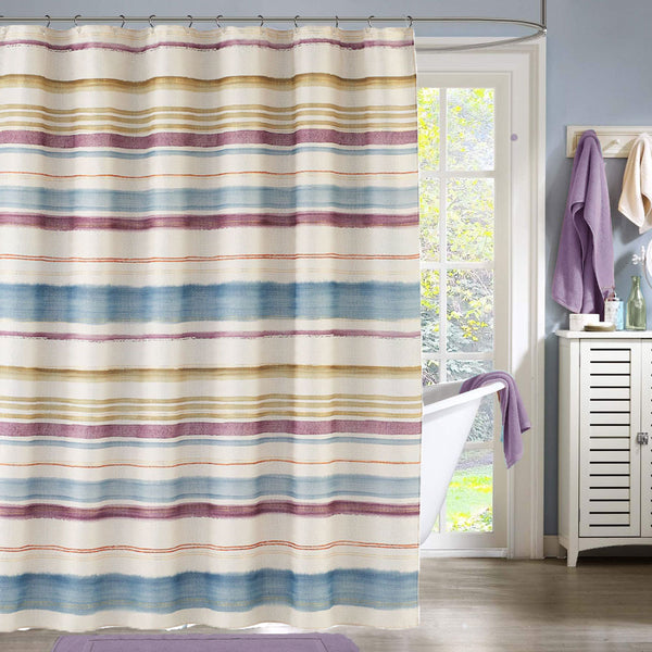 Multi Caymen Stripe Fabric Shower Curtain hanging on a shower curtain rod