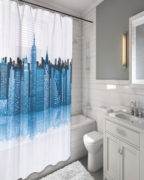 Blue Cityscape Fabric Shower Curtain hanging on a shower curtain rod