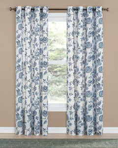 Denim Colette Printed Grommet Top Panel hanging on a decorative curtain rod