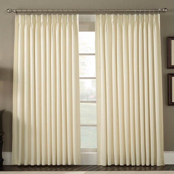 Natural Crosby Insulated Pinch Pleated Panel Pair hanging on a decorative curtain rod