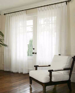 Custom Snow Voile Sheer By The Foot hanging on a decorative curtain rod
