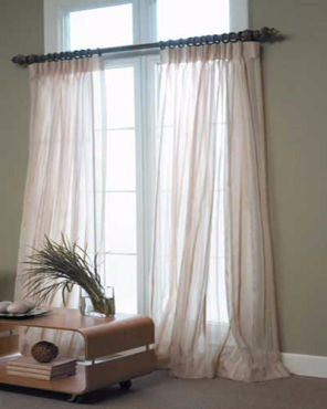 Custom Stripe Voile Sheer By The Foot hanging on a decorative curtain rod