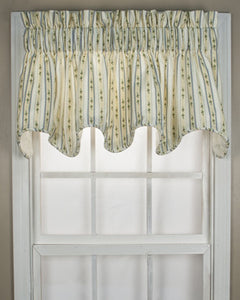 Cynthia Stripe Scalloped Valance hanging on a curtain rod