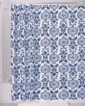 Blue Damask Fabric Shower Curtain hanging on a shower curtain rod