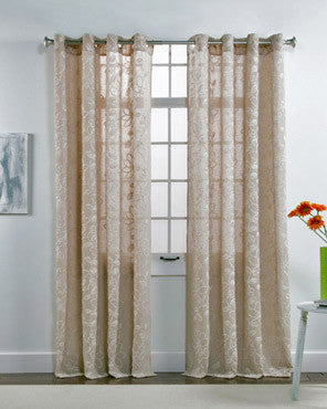 Taupe Darcy Chenille Embroidered Grommet Panel hanging on a decorative curtain rod