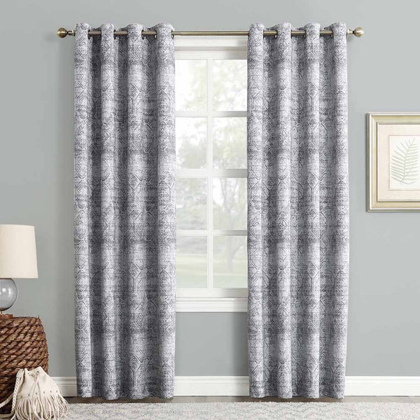 Indigo Sun Zero Darren Distressed Damask Blackout Grommet Top Panel hanging on from a decorative rod