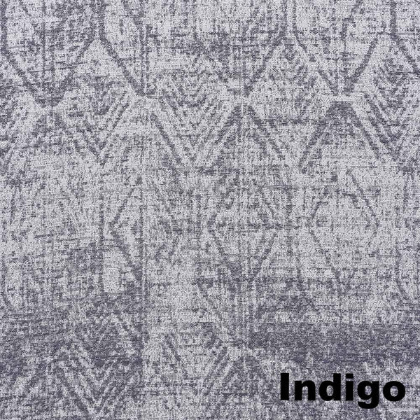 Up close shot of Indigo Sun Zero Darren Distressed Damask Blackout Grommet Top Panel fabric