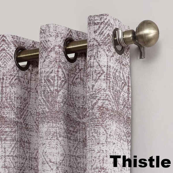 Close up of Thistle Sun Zero Darren Distressed Damask Blackout Grommet Top Panel showing grommets