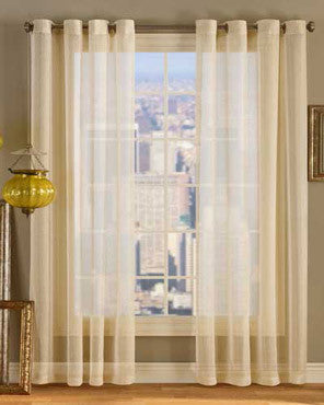 Gold Dazzle Metallic Sheer Grommet Top Panel hanging a decorative curtain rod