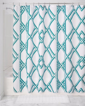 Green Deco Geo Fabric Shower Curtain hanging on a shower curtain rod
